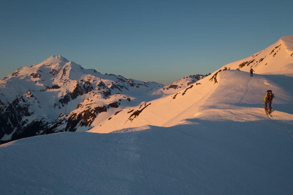 Skinning past Glacier Peak. Credit: Ben Starkey