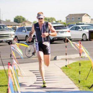 Ben Thomassen competing in a triathlon. Photo credit: BuDu Racing, LLC